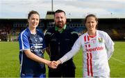16 June 2019; Karen McGrath of Waterford and Martina O'Brien of Cork shake hands across referee Seamus Mulvihill prior to the TG4 Ladies Football Munster Senior Football Championship Final match between Cork and Waterford at Fraher Field in Dungarvan, Co. Waterford. Photo by Harry Murphy/Sportsfile
