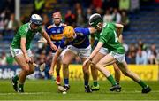 16 June 2019; Tony Cahill of Tipperary in action against Ethan Hurley, left, and Fergal O'Connor of Limerick during the Electric Ireland Munster GAA Minor Hurling Championship Round 5 match between Tipperary and Limerick in Semple Stadium in Thurles, Tipperary. Photo by Ray McManus/Sportsfile