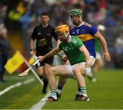 16 June 2019; Richie English of Limerick in action against Ronan Maher of Tipperary during the Munster GAA Hurling Senior Championship Round 5 match between Tipperary and Limerick at Semple Stadium in Thurles, Tipperary. Photo by Ray McManus/Sportsfile