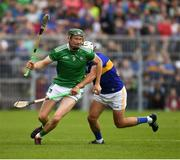16 June 2019; William O'Donoghue of Limerick in action against Patrick Maher of Tipperary during the Munster GAA Hurling Senior Championship Round 5 match between Tipperary and Limerick at Semple Stadium in Thurles, Tipperary. Photo by Ray McManus/Sportsfile