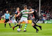 14 June 2019; Ronan Finn of Shamrock Rovers in action against Aaron Barry of Bohemians during the SSE Airtricity League Premier Division match between Bohemians and Shamrock Rovers at Dalymount Park in Dublin. Photo by Seb Daly/Sportsfile