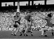 3 July 1983; Barney Rock of Dublin has a shot on goal blocked by Niall O'Sullivan and Padraig Lyons, right, of Meath. Leinster Senior Football Championship quarter-final replay, Meath v Dublin in Croke Park in Dublin. Photo by Ray McManus/Sportsfile.