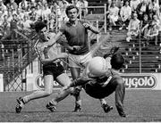 3 July 1983; Colm O'Rourke of Meath has a shot on goal despite the best efforts of Gerry Hargan and goalkeeper John O'Leary of Dublin. Leinster Senior Football Championship quarter-final replay, Meath v Dublin in Croke Park in Dublin. Photo by Ray McManus/Sportsfile.