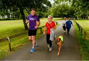 22 June 2019; Vhi ambassador and Olympian David Gillick was on hand to lead the warm up for parkrun participants before completing the 5km free event. Parkrunners enjoyed refreshments post event at the Vhi Rehydrate, Relax, Refuel and Reward areas. Parkrun in partnership with Vhi support local communities in organising free, weekly, timed 5k runs every Saturday at 9.30am. To register for a parkrun near you visit www.parkrun.ie. Pictured at the Templemore parkrun where Vhi hosted a special event to celebrate their partnership with parkrun Ireland is Vhi ambassador David Gillick and Jane McManus, from Roscrea, participating in her 71st parkrun, along with her dog Simba. Photo by Diarmuid Greene/Sportsfile