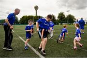 22 June 2019; Ahead of the start of the first ever Bank of Ireland Leinster Rugby Inclusion Camps on the 2nd July in Terenure RFC, the final training session for camp coaches was held in UCD today by Leinster Rugby Spirit Officer, Stephen Gore and Ken Moore, Summer Camp Co-ordinator. Also taking part in the training session were children and parents involved with the Down Syndrome Centre, one of Leinster Rugby's charity partners. The Bank of Ireland Leinster Rugby Inclusion Camps provide children with all disabilities aged between six and 15, a fun-filled three days of rugby during the summer holidays. The camps will take place in Terenure, Greystones, Navan, Tullamore and Newbridge and are focused on adapting rugby to meet the needs of camp-goers to maximise enjoyment and learning to play the Leinster Way. Further information is available at: https://www.leinsterrugby.ie/camps/inclusion-camps. Pictured are, Charlie O'Neill, aged 11, and Harrison Pender, aged 5, during the training session. Photo by Daire Brennan/Sportsfile
