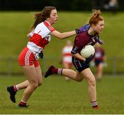 22 June 2019; Emer Fogarty of Westmeath in action against Sarah Heron of Derry during the Ladies Football All-Ireland U14 Bronze Final 2019 match between Derry and Westmeath at St Aidan's GAA Club in Templeport, Cavan. Photo by Ray McManus/Sportsfile