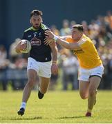 22 June 2019; Fergal Conway of Kildare in action against Declan Lynch of Antrim during the GAA Football All-Ireland Senior Championship Round 2 match between Antrim and Kildare at Corrigan Park in Belfast, Antrim. Photo by Ramsey Cardy/Sportsfile
