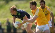 22 June 2019; Keith Cribbin of Kildare is tackled by Martin Johnston of Antrim during the GAA Football All-Ireland Senior Championship Round 2 match between Antrim and Kildare at Corrigan Park in Belfast, Antrim. Photo by Ramsey Cardy/Sportsfile