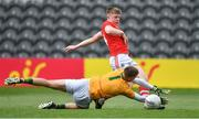 22 June 2019; Patrick Campbell of Cork fires a shot past Kerry goalkeeper Devon Burns resulting in Cork's second goal after a deflection during the Electric Ireland Munster GAA Football Minor Championship Final match between Cork and Kerry at Páirc Ui Chaoimh in Cork.  Photo by Brendan Moran/Sportsfile