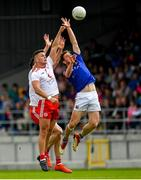 22 June 2019; Daniel Mimnagh of Longford in action against Michael McKernan of Tyrone during the GAA Football All-Ireland Senior Championship Round 2 match between Longford and Tyrone at Glennon Brothers Pearse Park in Longford.  Photo by Eóin Noonan/Sportsfile