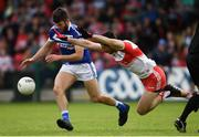 22 June 2019; Daniel O'Reilly of Laois in action against Chrissy McKaigue of Derry during the GAA Football All-Ireland Senior Championship Round 2 match between Derry and Laois at Derry GAA Centre of Excellence in Owenbeg, Derry. Photo by Ramsey Cardy/Sportsfile