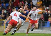 22 June 2019; Padraig McCormack of Longford is tackled by Michael McKernan, left, and Michael Cassidy of Tyrone during the GAA Football All-Ireland Senior Championship Round 2 match between Longford and Tyrone at Glennon Brothers Pearse Park in Longford.  Photo by Eóin Noonan/Sportsfile
