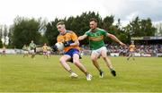 22 June 2019; Gavin Cooney of Clare in action against Conor Reynolds of Leitrim during the GAA Football All-Ireland Senior Championship Round 2 match between Leitrim and Clare at Avantcard Páirc Seán Mac Diarmada in Carrick-on-Shannon, Leitrim. Photo by Daire Brennan/Sportsfile