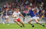 22 June 2019; Michael McKernan of Tyrone in action against Joseph Hagan of Longford during the GAA Football All-Ireland Senior Championship Round 2 match between Longford and Tyrone at Glennon Brothers Pearse Park in Longford.  Photo by Eóin Noonan/Sportsfile