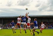 22 June 2019; Kyle Coney of Tyrone in action against Aidan McElligott of Longford during the GAA Football All-Ireland Senior Championship Round 2 match between Longford and Tyrone at Glennon Brothers Pearse Park in Longford.  Photo by Eóin Noonan/Sportsfile