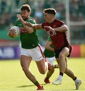 22 June 2019; Aidan O'Shea of Mayo in action against Pirce Laverty of Downduring the GAA Football All-Ireland Senior Championship Round 2 match between Down and Mayo at Pairc Esler in Newry, Down.  Photo by Oliver McVeigh/Sportsfile