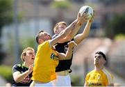 22 June 2019; Matthew Fitzpatrick of Antrim in action against Kevin Feely of Kildare during the GAA Football All-Ireland Senior Championship Round 2 match between Antrim and Kildare at Corrigan Park in Belfast, Antrim. Photo by Ramsey Cardy/Sportsfile
