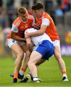22 June 2019; Fintan Kelly of Monaghan is tackled by Aidan Nugent, right, and Rian O'Neill of Armagh during the GAA Football All-Ireland Senior Championship Round 2 match between Monaghan and Armagh at St Tiarnach's Park in Clones, Monaghan. Photo by Ray McManus/Sportsfile