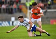 22 June 2019; Fintan Kelly of Monaghan is tackled by Aidan Nugent of Armagh during the GAA Football All-Ireland Senior Championship Round 2 match between Monaghan and Armagh at St Tiarnach's Park in Clones, Monaghan.  Photo by Ray McManus/Sportsfile