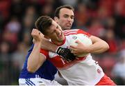 22 June 2019; Shane McGuigan of Derry is tackled by Gareth Dillon of Laois during the GAA Football All-Ireland Senior Championship Round 2 match between Derry and Laois at Derry GAA Centre of Excellence in Owenbeg, Derry. Photo by Ramsey Cardy/Sportsfile