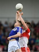 22 June 2019; Stephen Attride of Laois in action against Shane McGuigan of Derry during the GAA Football All-Ireland Senior Championship Round 2 match between Derry and Laois at Derry GAA Centre of Excellence in Owenbeg, Derry. Photo by Ramsey Cardy/Sportsfile