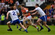 22 June 2019; Andrew Murin of Armagh is tackled by Conor Boyle, right, and Kieran Duffy of Monaghan  during the GAA Football All-Ireland Senior Championship Round 2 match between Monaghan and Armagh at St Tiarnach's Park in Clones, Monaghan.  Photo by Ray McManus/Sportsfile