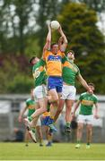 22 June 2019; Cathal O'Connor of Clare in action against Ryan O'Rourke, left, and Shane Moran of Leitrim during the GAA Football All-Ireland Senior Championship Round 2 match between Leitrim and Clare at Avantcard Páirc Seán Mac Diarmada in Carrick-on-Shannon, Leitrim. Photo by Daire Brennan/Sportsfile