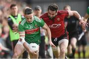 22 June 2019; Evan Regan of Mayo in action against Kevin McKernan of Down during the GAA Football All-Ireland Senior Championship Round 2 match between Down and Mayo at Pairc Esler in Newry, Down.  Photo by Oliver McVeigh/Sportsfile