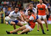 22 June 2019; Jamie Clarke of Armagh is tackled by Ryan Wylie, left, and Conor Boyle of Monaghan during the GAA Football All-Ireland Senior Championship Round 2 match between Monaghan and Armagh at St Tiarnach's Park in Clones, Monaghan.  Photo by Ray McManus/Sportsfile