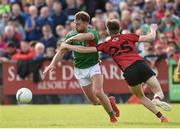 22 June 2019; Aidan O'Shea of Mayo in action against Owen McCabe of Down during the GAA Football All-Ireland Senior Championship Round 2 match between Down and Mayo at Pairc Esler in Newry, Down.  Photo by Oliver McVeigh/Sportsfile