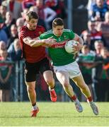 22 June 2019; Lee Keegan of Mayo in action against Conor Poland of Down during the GAA Football All-Ireland Senior Championship Round 2 match between Down and Mayo at Pairc Esler in Newry, Down.  Photo by Oliver McVeigh/Sportsfile