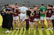 22 June 2019; The Westmeath team, joined by supporters Senan Lawlor and Lola McCarthy, huddle together after the GAA Football All-Ireland Senior Championship Round 2 match between Westmeath and Limerick at TEG Cusack Park in Mullingar, Co. Westmeath. Photo by Diarmuid Greene/Sportsfile