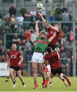 22 June 2019; Aidan O'Shea of Mayo in action against Conor Poland of Down during the GAA Football All-Ireland Senior Championship Round 2 match between Down and Mayo at Pairc Esler in Newry, Down.  Photo by Oliver McVeigh/Sportsfile