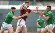 22 June 2019; Joe Halligan of Westmeath in action against Brian Fanning, left, and Jamie Lee of Limerick during the GAA Football All-Ireland Senior Championship Round 2 match between Westmeath and Limerick at TEG Cusack Park in Mullingar, Co. Westmeath. Photo by Diarmuid Greene/Sportsfile