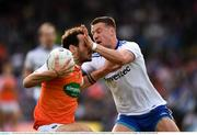 22 June 2019; Jamie Clarke of Armagh is tackled by Ryan Wylie of Monaghan during the GAA Football All-Ireland Senior Championship Round 2 match between Monaghan and Armagh at St Tiarnach's Park in Clones, Monaghan.  Photo by Ray McManus/Sportsfile