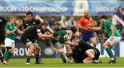 22 June 2019; Ronan Watters of Ireland, centre, is tackled during the World Rugby U20 Championship Pool B match between New Zealand and Ireland at Club Old Resian in Rosario, Argentina. Photo by Florencia Tan Jun/Sportsfile