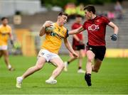 23 June 2019; Dermot McErlaine of Antrim in action against Ruairi McCormack of Down during the EirGrid Ulster GAA Football U20 Championship Round match between Down and Antrim at St Tiernach's Park in Clones, Monaghan. Photo by Oliver McVeigh/Sportsfile
