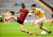23 June 2019; Ardan McAvoy of Down in action against  Ronan Kelly of Antrim during the EirGrid Ulster GAA Football U20 Championship Round match between Down and Antrim at St Tiernach's Park in Clones, Monaghan. Photo by Oliver McVeigh/Sportsfile