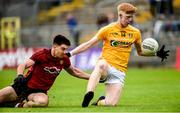 23 June 2019;  Pat Shivers of Antrim in action against Ruairi McCrickard of Down during the EirGrid Ulster GAA Football U20 Championship Round match between Down and Antrim at St Tiernach's Park in Clones, Monaghan. Photo by Oliver McVeigh/Sportsfile