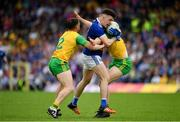 23 June 2019; Dara McVeety of Cavan in action against Paddy McGrath, left, and Hugh McFadden of Donegal during the Ulster GAA Football Senior Championship Final match between Donegal and Cavan at St Tiernach's Park in Clones, Monaghan. Photo by Sam Barnes/Sportsfile