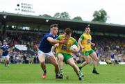 23 June 2019; Niall O'Donnell of Donegal in action against Conor Brady of Cavan during the Ulster GAA Football Senior Championship Final match between Donegal and Cavan at St Tiernach's Park in Clones, Monaghan. Photo by Ramsey Cardy/Sportsfile