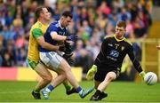23 June 2019; Conor Rehill of Cavan misses a goal chance under pressure from Neil McGee, left, and Shaun Patton of Donegal during the Ulster GAA Football Senior Championship Final match between Donegal and Cavan at St Tiernach's Park in Clones, Monaghan. Photo by Sam Barnes/Sportsfile