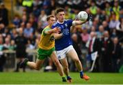 23 June 2019; Dara McVeety of Cavan in action against Stephen McMenamin of Donegal during the Ulster GAA Football Senior Championship Final match between Donegal and Cavan at St Tiernach's Park in Clones, Monaghan. Photo by Sam Barnes/Sportsfile