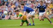23 June 2019; Niall O'Donnell  of Donegal in action against Oisin Kiernan of Cavan during the Ulster GAA Football Senior Championship Final match between Donegal and Cavan at St Tiernach's Park in Clones, Monaghan. Photo by Oliver McVeigh/Sportsfile