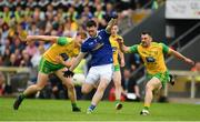 23 June 2019; Conor Rehill of Cavan in action against Paddy McGrath, right, and Hugh McFadden of Donegal during the Ulster GAA Football Senior Championship Final match between Donegal and Cavan at St Tiernach's Park in Clones, Monaghan. Photo by Sam Barnes/Sportsfile