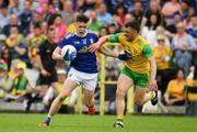 23 June 2019; Dara McVeety of Cavan in action against Paddy McGrath of Donegal during the Ulster GAA Football Senior Championship Final match between Donegal and Cavan at St Tiernach's Park in Clones, Monaghan. Photo by Sam Barnes/Sportsfile