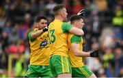 23 June 2019; Jamie Brennan of Donegal, right  celebrates with Ryan McHugh, left, and  Patrick McBrearty after scoring his side's first goal of the game during the Ulster GAA Football Senior Championship Final match between Donegal and Cavan at St Tiernach's Park in Clones, Monaghan. Photo by Sam Barnes/Sportsfile