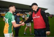 23 June 2019; Offaly manager John Maughan shakes hands with Joseph O'Connor of Offaly following the GAA Football All-Ireland Senior Championship Round 2 match between Offaly and Sligo at Bord na Mona O'Connor Park in Tullamore, Offaly. Photo by Harry Murphy/Sportsfile