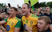 23 June 2019; Michael Murphy, centre, and Stephen McMenamin of Donegal celebrate with supporters following the Ulster GAA Football Senior Championship Final match between Donegal and Cavan at St Tiernach's Park in Clones, Monaghan. Photo by Sam Barnes/Sportsfile