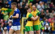 23 June 2019; Jamie Brennan of Donegal, left, and Michael Murphy celebrate at the final whistle as Killian Clarke of Cavan leaves the field dejected following the Ulster GAA Football Senior Championship Final match between Donegal and Cavan at St Tiernach's Park in Clones, Monaghan. Photo by Sam Barnes/Sportsfile